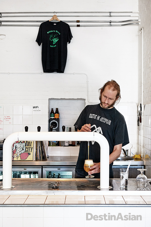 Brewmaster Eric Nordin behind the taps in the tasting room at Butcher's Tears.