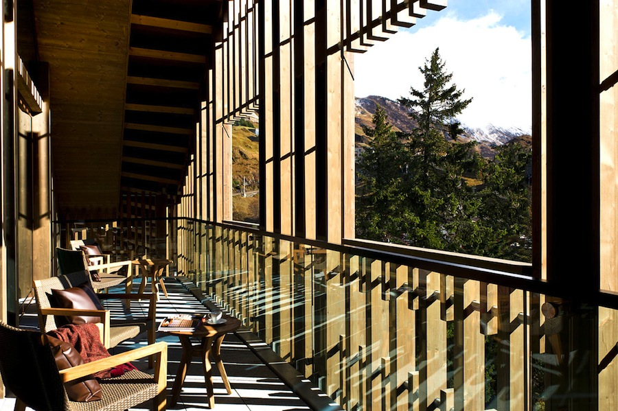 A balcony looking out onto the Swiss Alps.