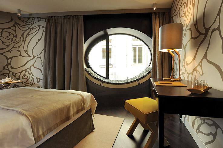 Guest quarters at the 33-room Hotel Topazz come, quite literally, with window seats.