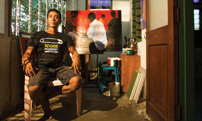 Artist Yan Naing Tun at his home studio near Yangon's Inya Lake.