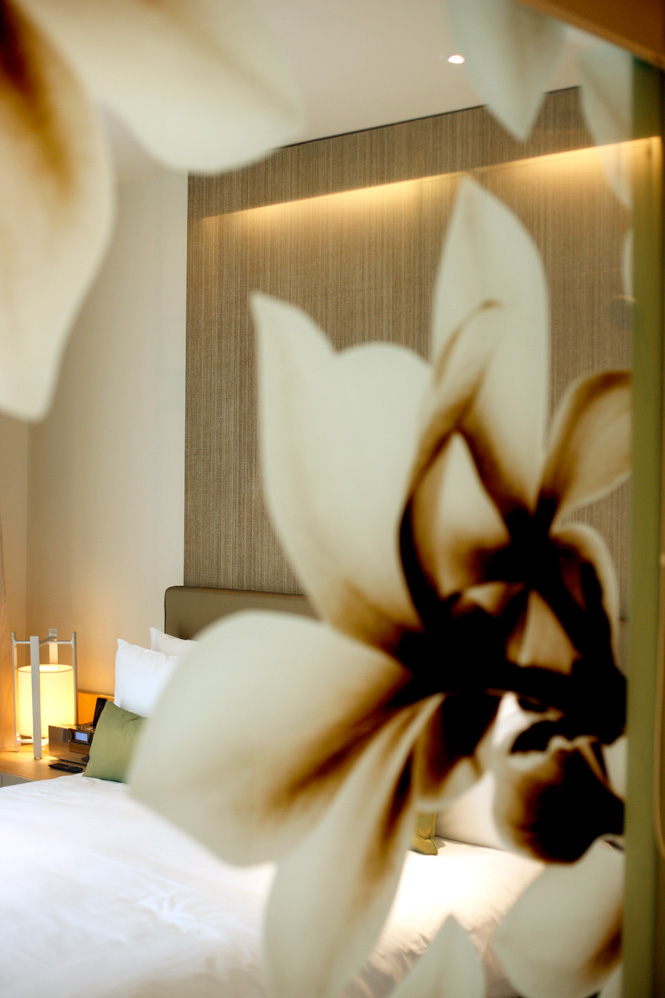 Deluxe rooms are accented by frangipani motifs.