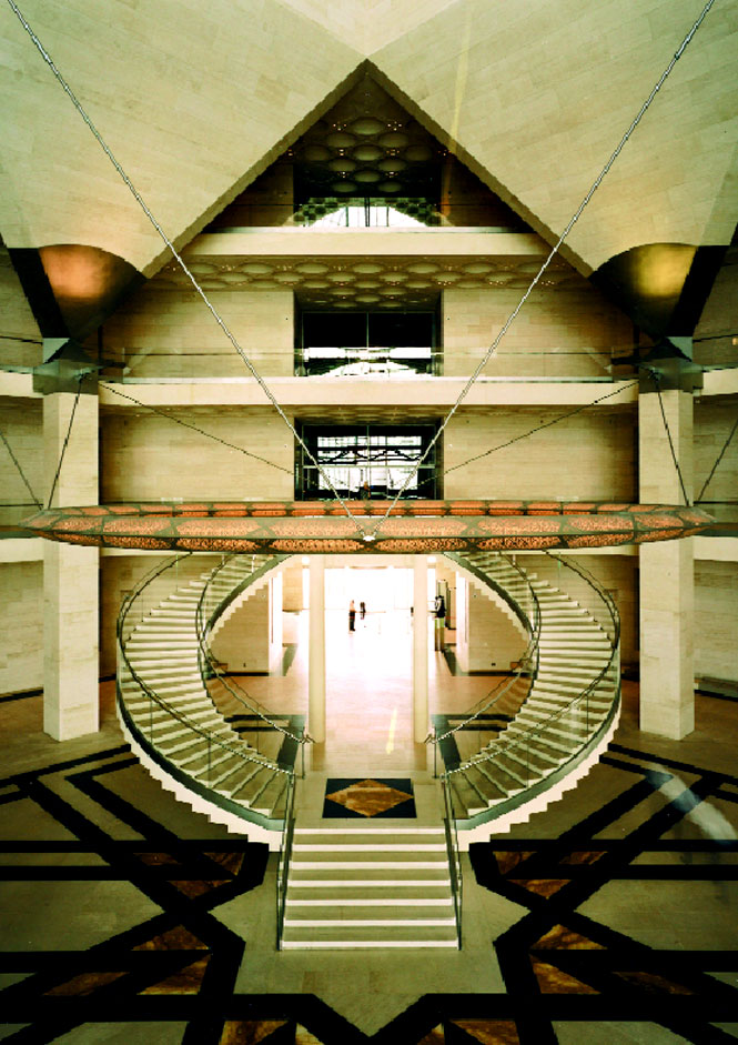 A double stairway leads to the museum's second-floor galleries.