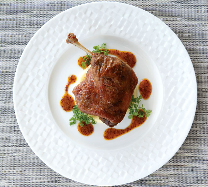 Duck confit with foie gras– stuffed cabbage and porcini mushrooms.