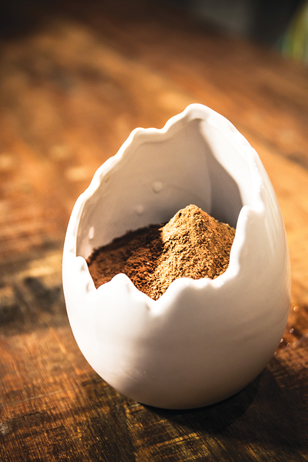 The Milo Dinosaur at The Envoy combines Absolut Elyx, Godiva chocolate liqueur, milk, and Milo powder in a dinosaur egg cup.