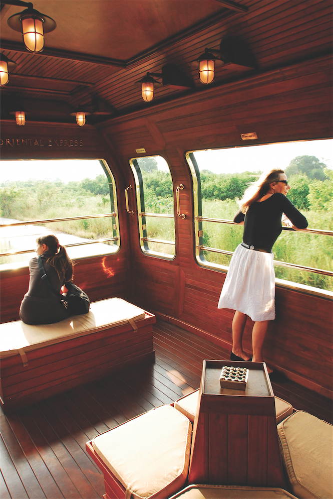 Taking in the views from E&O's teak-planked observation car.