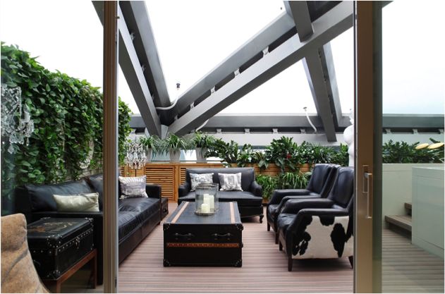 Masculine furnishings on the indoor terrace of the Eternal Bachelor suite.