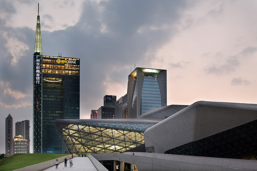 The Guangzhou Opera House merges with the city's sleek skyline.