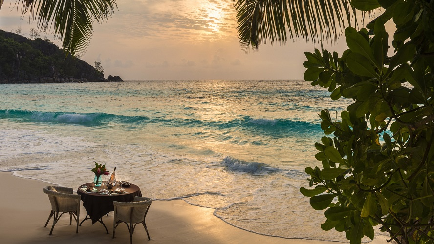 On the beach at the Four Seasons Resort Seychelles.
