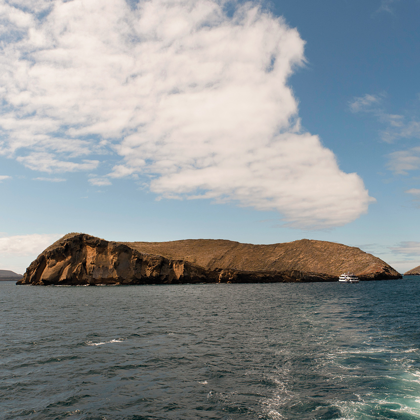 The approach to Santiago Island, where visitors can hike across dry lava flows and snorkel with fur seals.