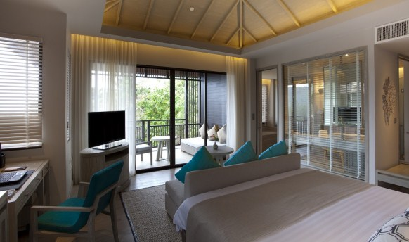 Floor-to-ceiling windows give guests spectacular views of the ocean.
