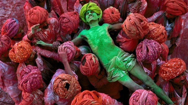 One of Mccurry's photographs taken during a Holi festival in India, where he spent an extensive amount of time travelling.
