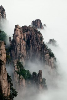 Among the mist-wreathed peaks of eastern China's Huangshan range.