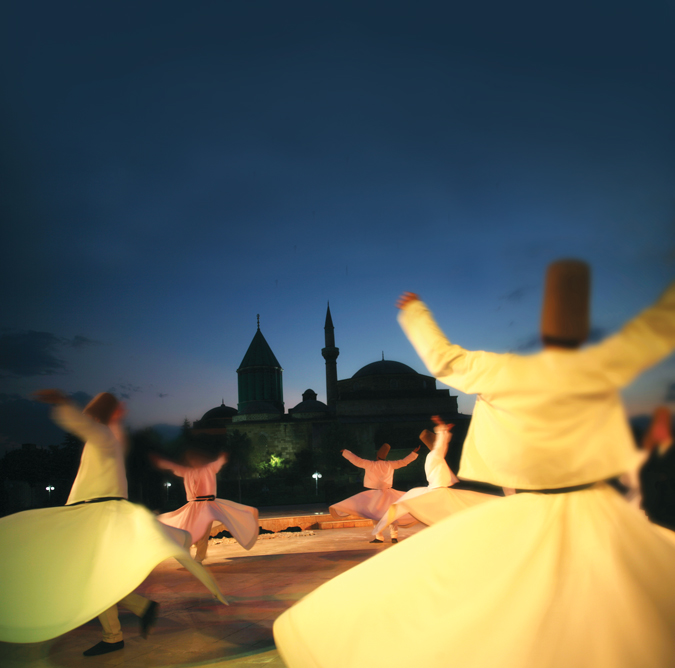Dervishes performing in the gardens of Konya's Mevlana Museum (iStock).