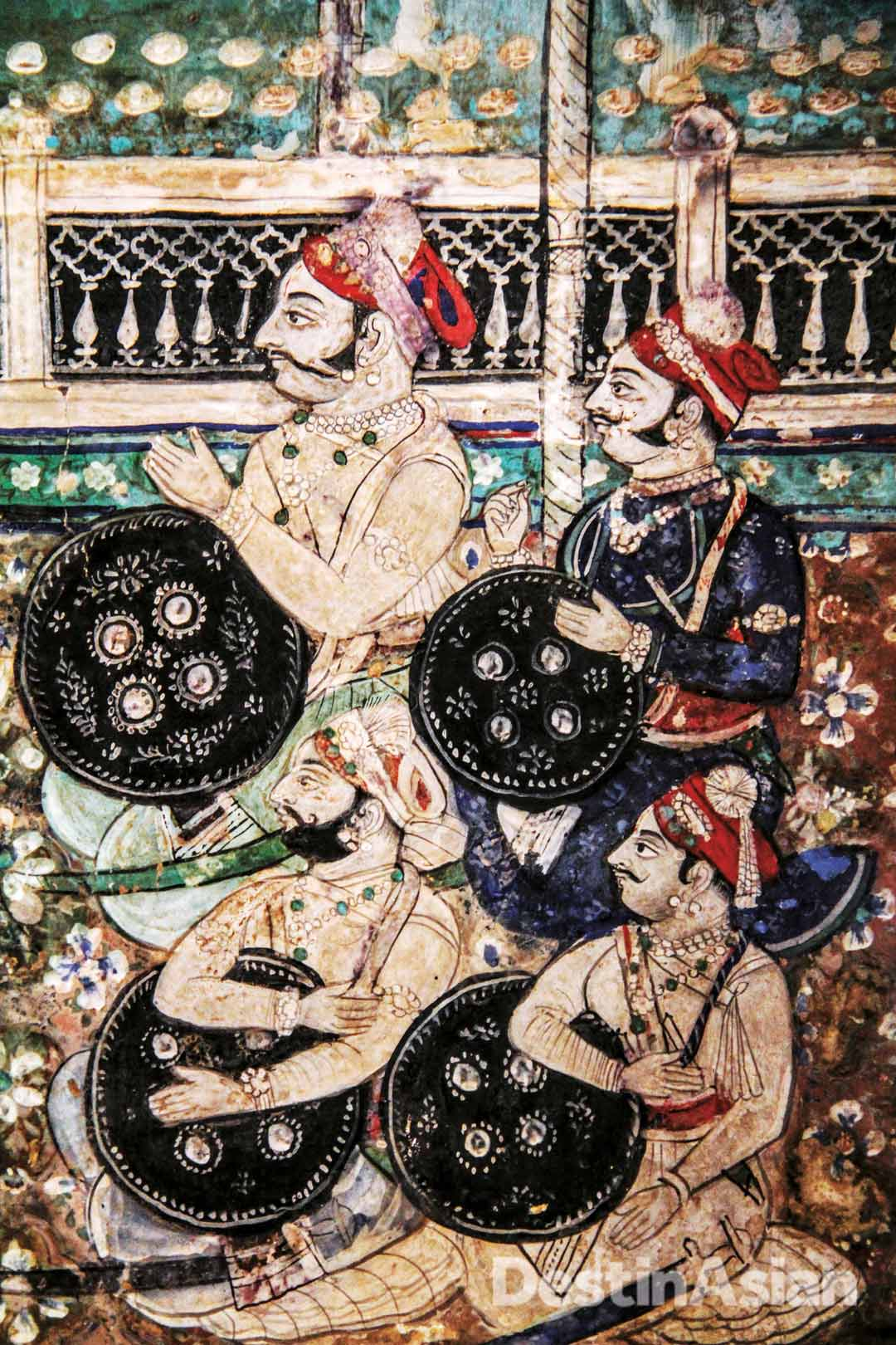 A mural detail in the Chitrashala depicting Rajput warriors during an audience with their raja.