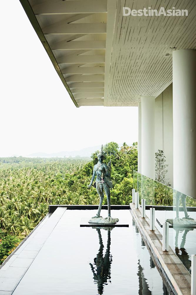 A statue outside the InterContinental's lobby depicting a kinnara, a half-human, half-bird creature from Thai mythology.