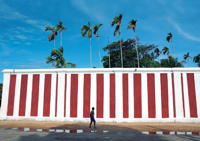 Stripe The distinctively striped outer wall of the Nallur Kandaswamy Temple