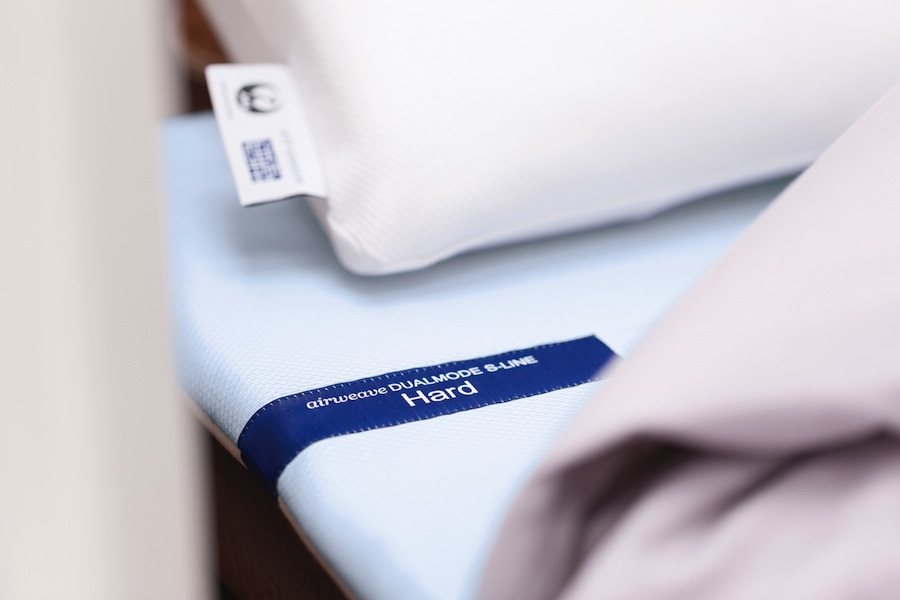 The firmer side of the airweave mattress.