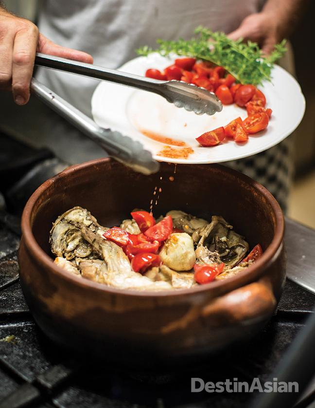 Chef Agostino d'Ambra preparing coniglio all'ischitana - a traditional rabbit stew - at Trattoria Il Focolare on the island of Ischia.