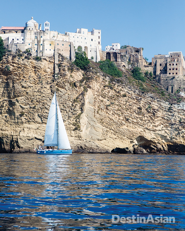 Sailing past the medieval town of Terra Murata on the southeast coast of Procida.