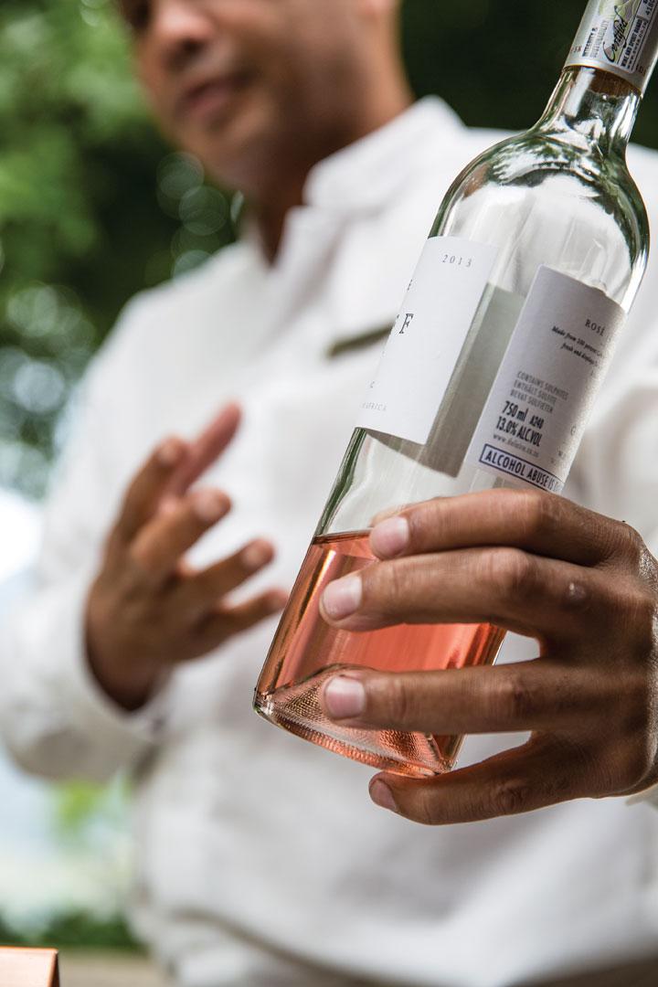 A sommelier discussing the finer points of the estate's cabernet franc rosé.