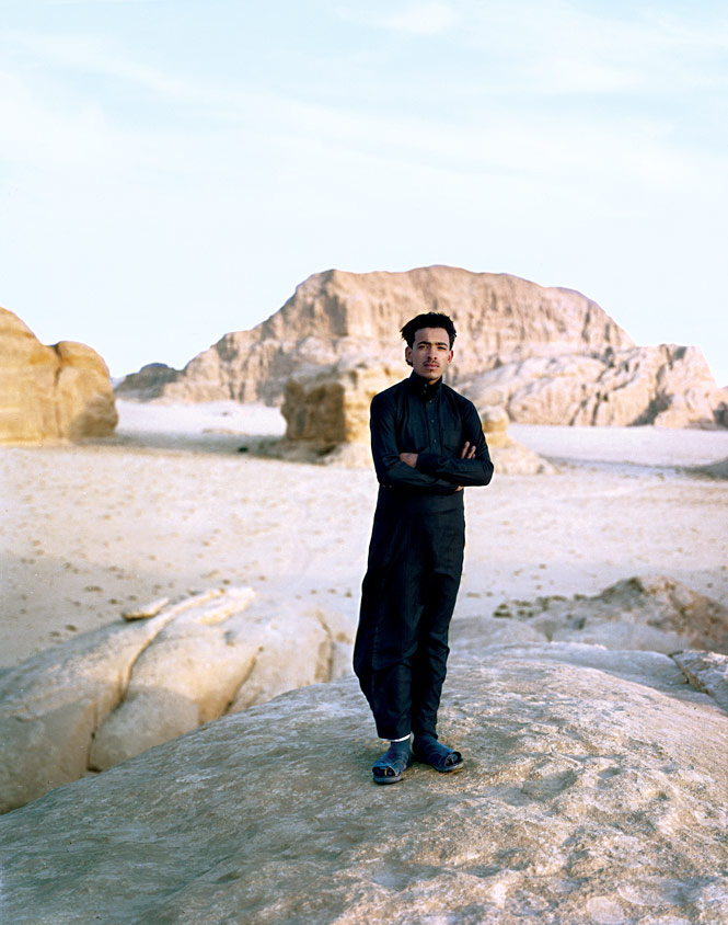 A Bedouin guide in the sandy expanse of Wadi Rum, a 720-square-kilometer valley carved out of sandstone  and granite in southern Jordan.