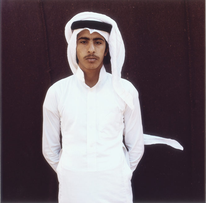 A young Bedouin man in traditional dishdasha.