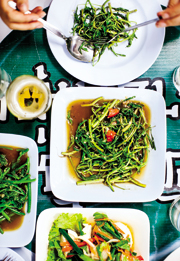 Stir-fried water spinach (and cold beer) makes a regular appearance on tables in northtern Thailand