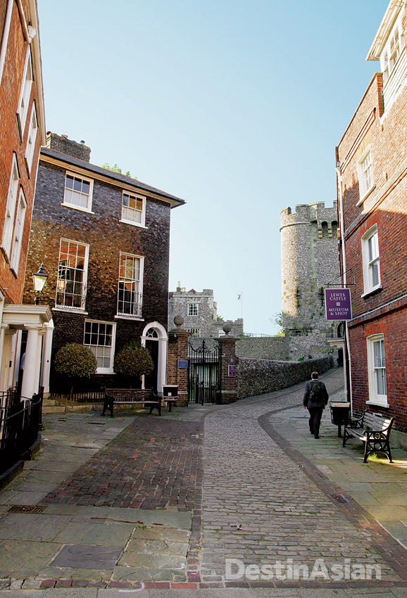 A Norman-era castle looms above the cobbled streets of the town of Lewes.