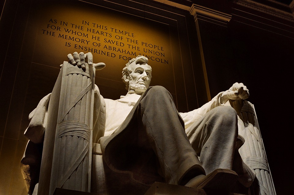 The inscription of gratitude glows behind the sculpture of Abraham Lincoln every night.