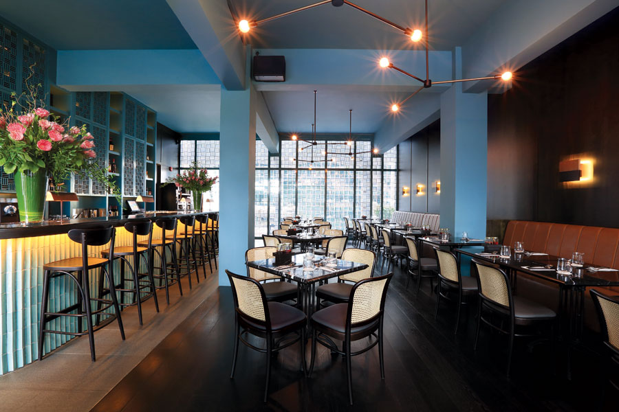 The new Longtail Brasserie features Southeast Asian flavors in a harbor-front setting.