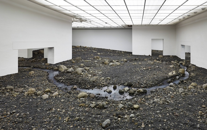 The giant riverbed landscape unfolds throughout the galleries of the south wing.