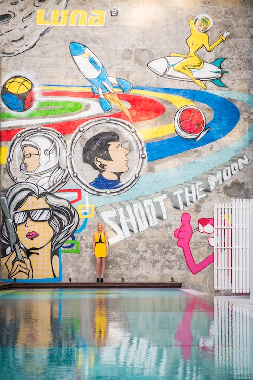 Melanie Hall poolside at the new Luna2 Studios with original graffiti art by Janoer Prasojo Moekti and zE.