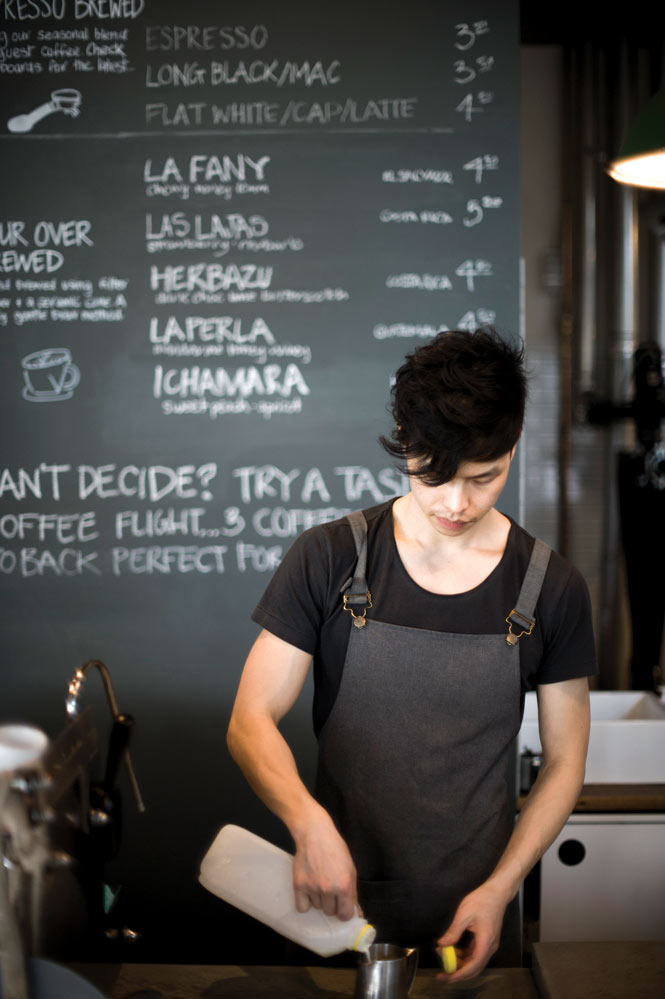 a barista at Dukes Coffee Roasters, on  the edge of Prahran.