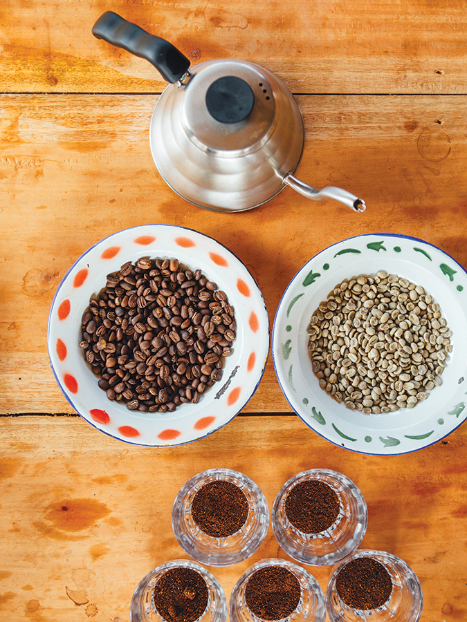 Beans before and after roasting on display at the Malabar Mountain plantation.