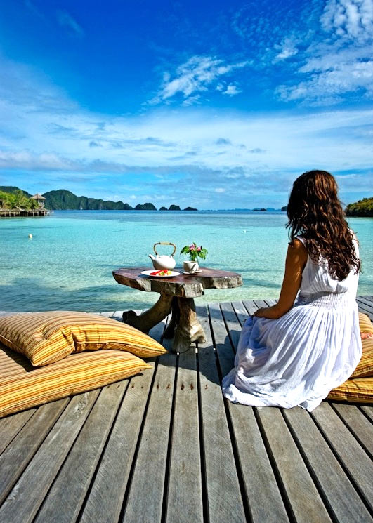Relaxing on a seaside deck at Misool Eco Resort.