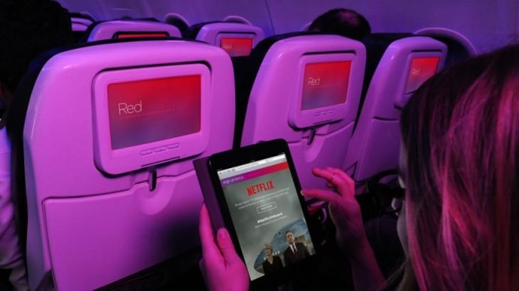 A passenger accessing Netflix on a Virgin America flight.