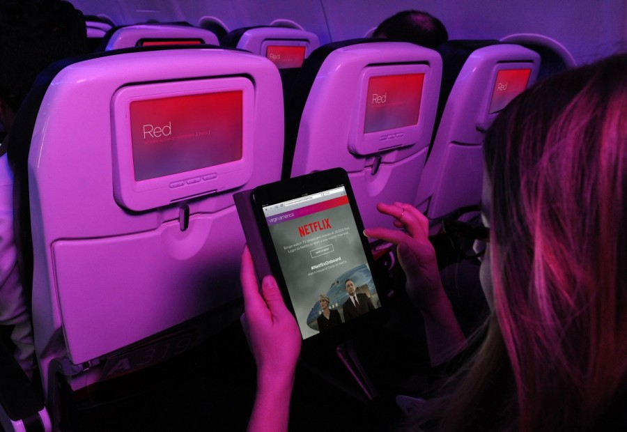 A passenger accessing Netflix on a Virgin America flight.