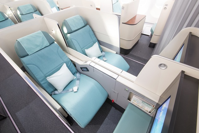 Each seat comes with an ottoman and can be separated with a privacy panel.