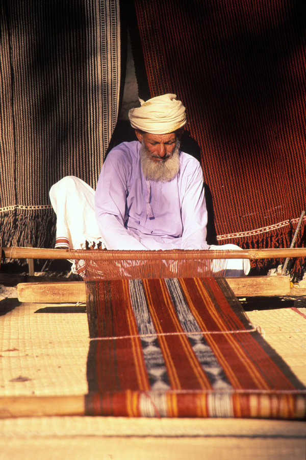 A Beouin weaver in the Wahiba Sands desert in Oman.