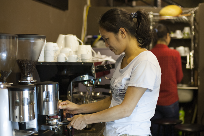 A barista at fair trade cafe Oriberry.
