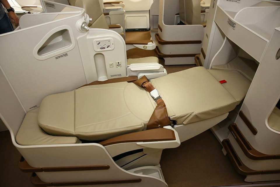 Philippine Airlines' new business-class seat transforms into a lie-flat bed.
