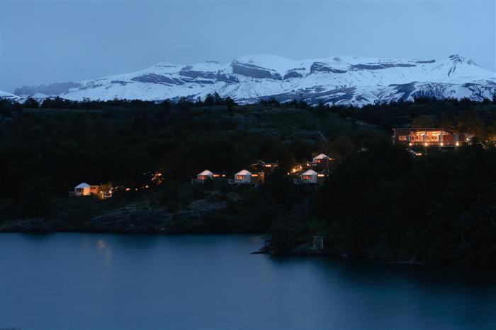Patagonia, the first luxury camp in South America, at dusk.