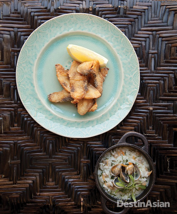 Fried stone bass with cockles and coriander-scented rice at chef Vasco Lello's Flores do Bairro.