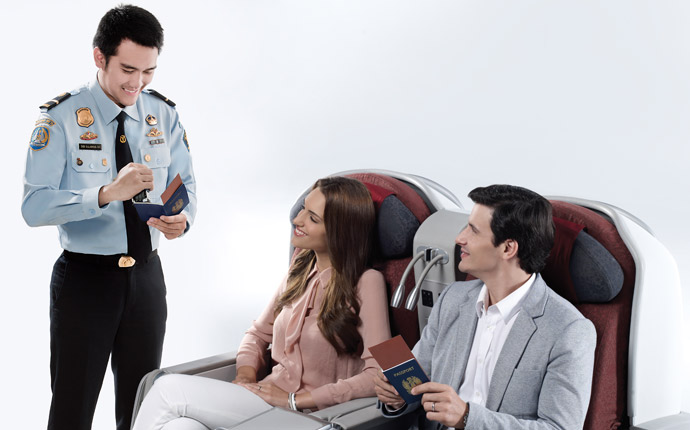 Immigration officers conduct passport checks while in the air.