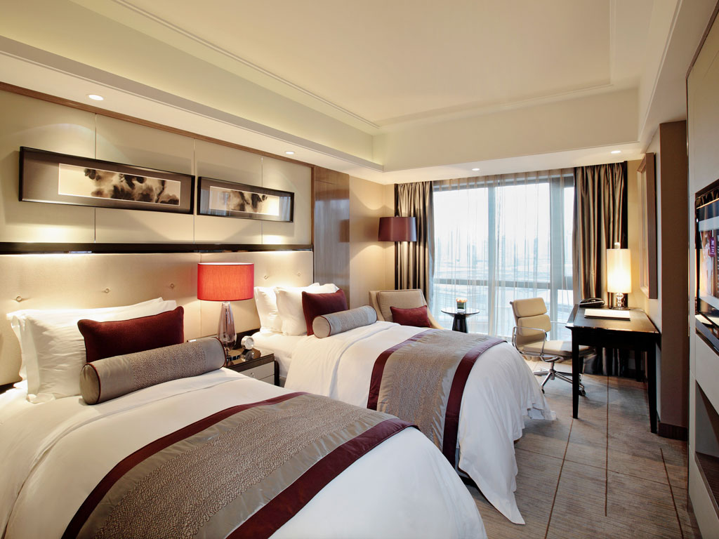 Inside one of the well-appointed rooms at Pullman Shanghai Jing An .