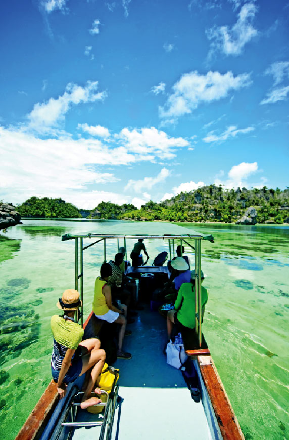 Touring the crystal-clear waters around Misool Eco Resort.