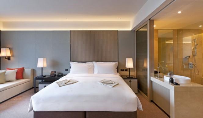 A room in the daytime at the Okura Prestige Bangkok hotel.