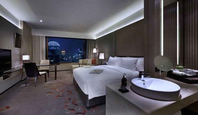 A room at night at the Okura Prestige Bangkok hotel.