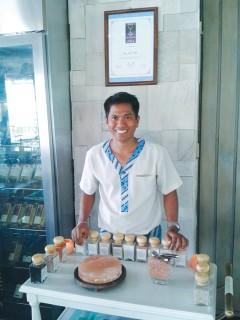 Sommai Wooniem poses with his salt jars.