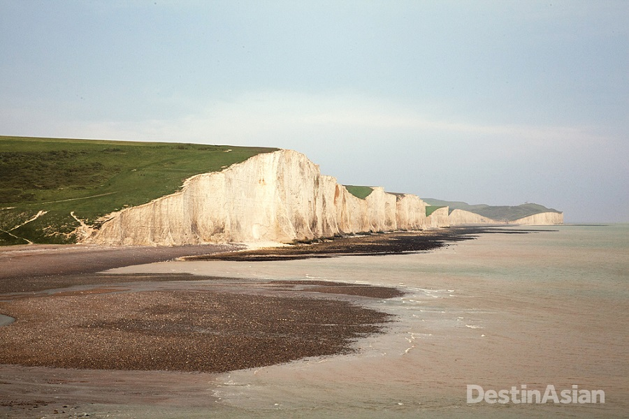 Looking across the Cuckmere Estuary to the Seven Sisters, a series of chalk cliffs that runs eastward from Seaford toward Eastbourne.